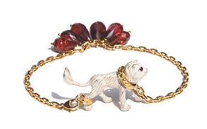 gold plated silver bangle, civilized savages jewellery collection,lion, garnets drop shape