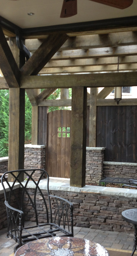 Outdoor Structures Knoxville TN, landscape structures knoxville tn, timber framed covered pato with stone retaining walls in Knoxville TN.