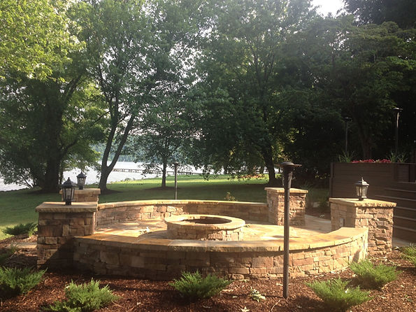 Beautiful stone patio knoxville tn with a fire pit knoxville tn and retaining wall Knoxville TN that was designed and installed by Knoxville Land Design