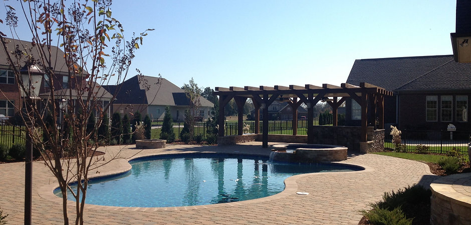 Beautiful paver patio knoxville tn around a swimming pool with paver patio design knoxville tn and installed by Knoxville Land Design.