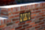 Brick retaining wall knoxville tn with a handmade tile inlay with retaining wall design knoxville tn and installed by Knoxville Land Design in Knoxville TN, Retaining Walls Knoxville TN, retaining walls knoxville, retaining wall contractors knoxville tn, retaining wall design knoxville, retaining wall builder knoxville, retaining wall installers knoxville tn, knoxville retaining walls, knoville retaining wall contractors, stone retaining wall, stacked stone retaning wall, masonry retaining walls