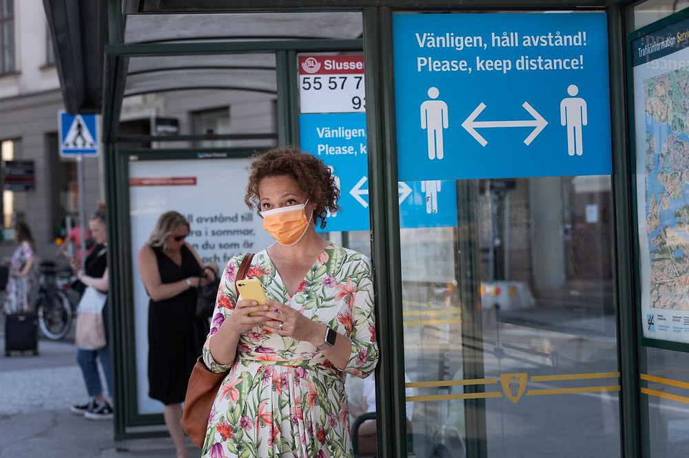 A woman wears a mask in Sweden (Photo Credit: Reuters)