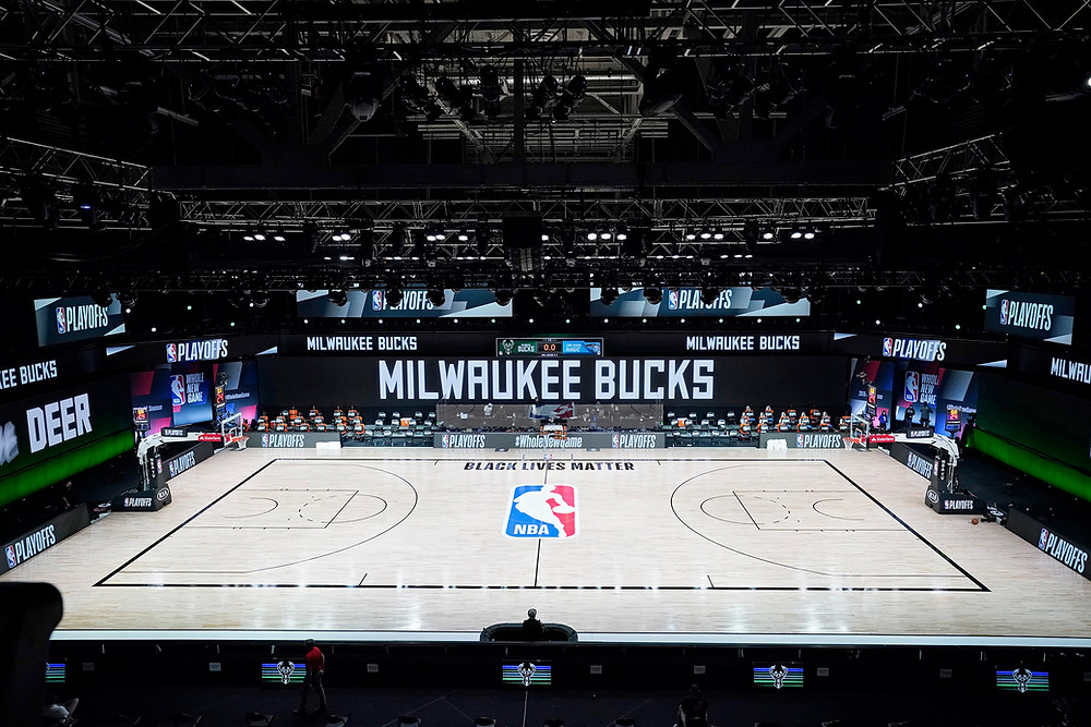 Milwaukee Bucks players refused to play a playoff game in protest (Photo Credit: NBC News)