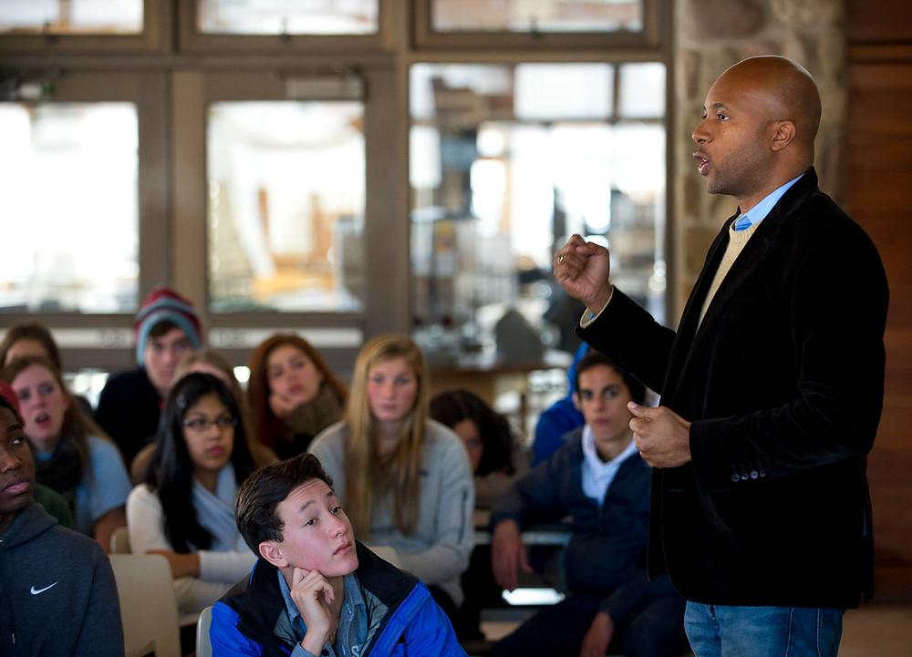A speaker at an Interschool event (Photo Credit: Interschool)