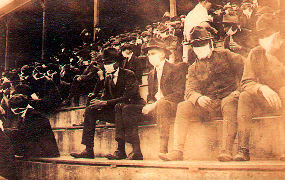 Masked spectators at a college football game in 1918 (Photo Credit: The Oregonian)