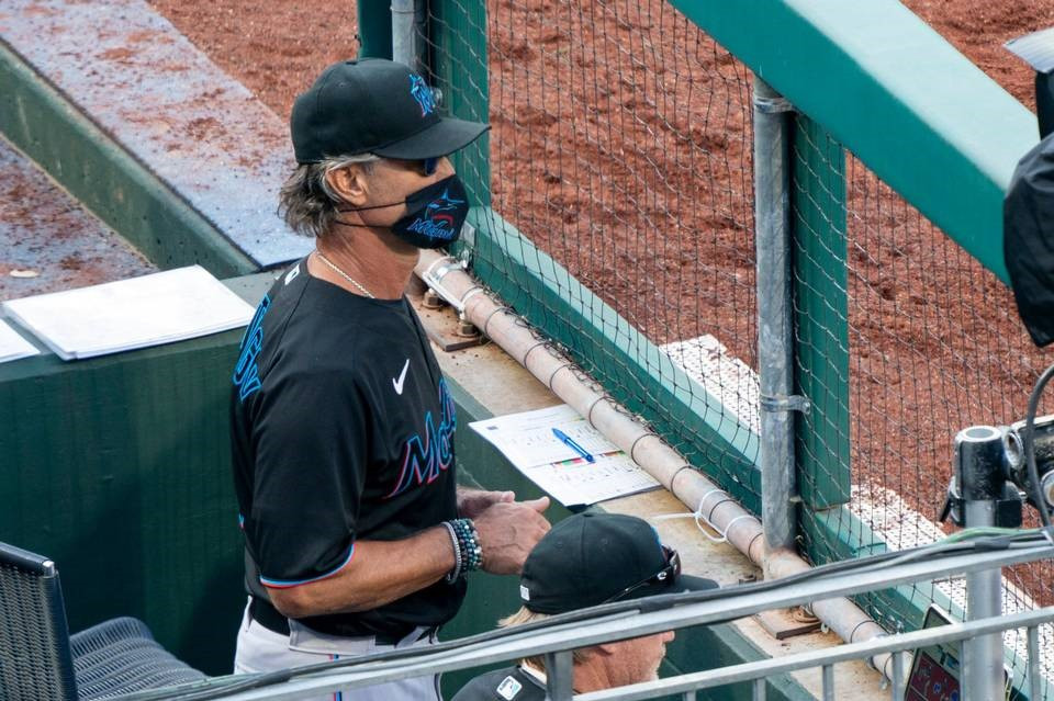 Miami Marlins' manager Don Mattingly looks out from the dugout (Photo Credit: Miami Herald)