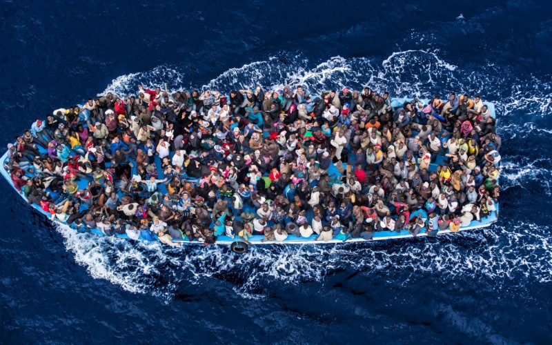 African migrants packed on a boat to Europe (Photo Credit: Global Risk Insights)