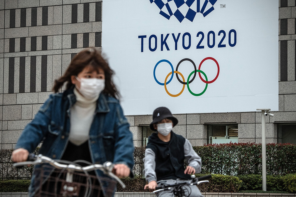An advertisement for the canceled Tokyo 2020 Olympics (Photo Credit: Time)