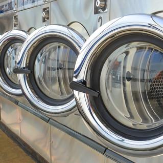 stock-photo-row-of-industrial-laundry-ma