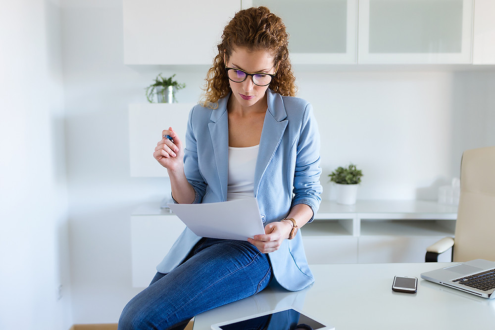Woman reading a heating system warranty