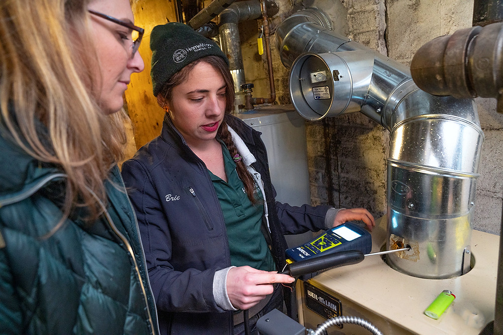 Home Energy Specialist performing a combustion safety test