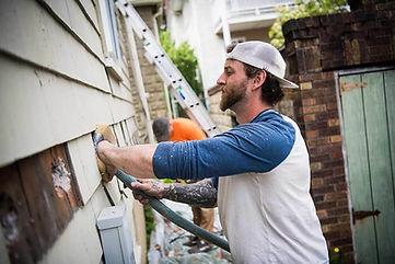 HWE-contractor-installing-insulation.jpg