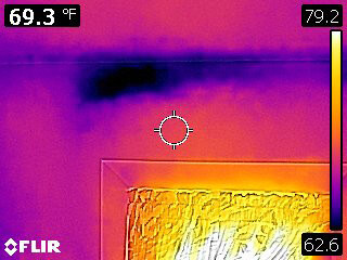Walls above a heating air vent show dark (cold) spots that may be lacking insulation.