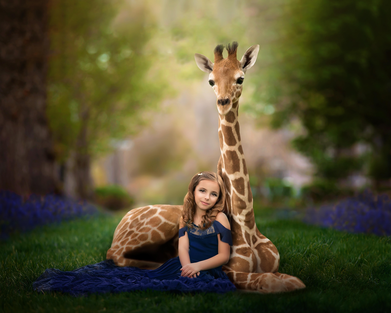 Sweet girl and adorable baby giraffe