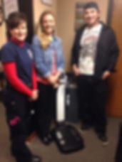 Heidi, Kara, and Nick stand with the InBody Composition Machine