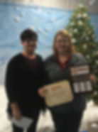 Becky Nichter, DoN, presents the Archie Award to Kristina Rauscher, CNA at PMC's Extended Care Facility. Thank you for your hard work & dedication!