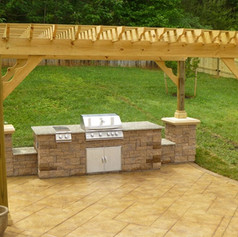 Stamped concrete outdoor kitchen designs by Greystone Masonry