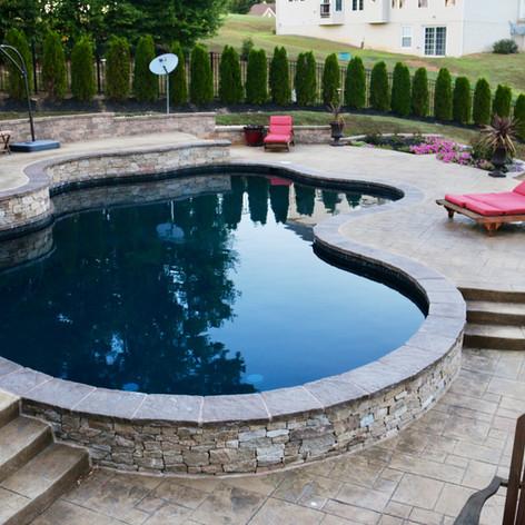 Stamped Concrete Pool Decks by Greystone Masonry