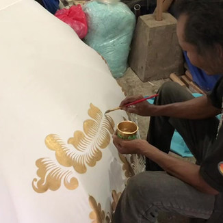 Our master painter at work for Bali Parasol.com