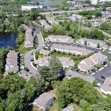 Heron Pond drone photo of neighborhood with pond