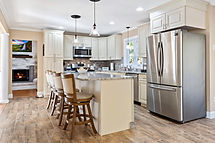 kitchen with white cabinets and granite counters and center island