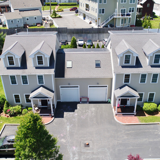 30 White drone photo of above two homes