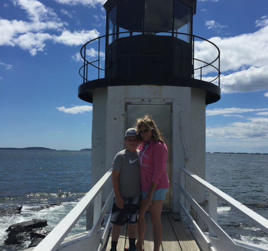 Gwen and her son at a lighthouse