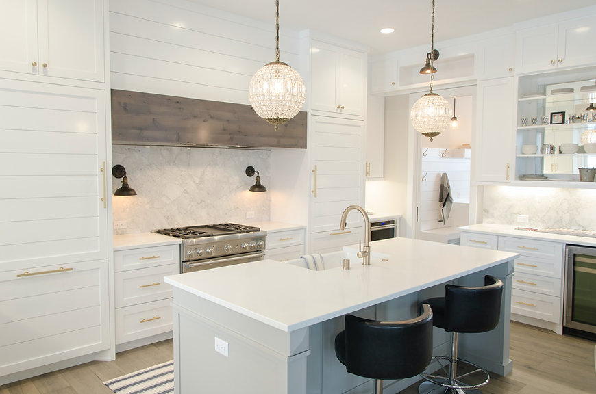 Luxury Home Kitchen with White Cabinets and Gold Accents