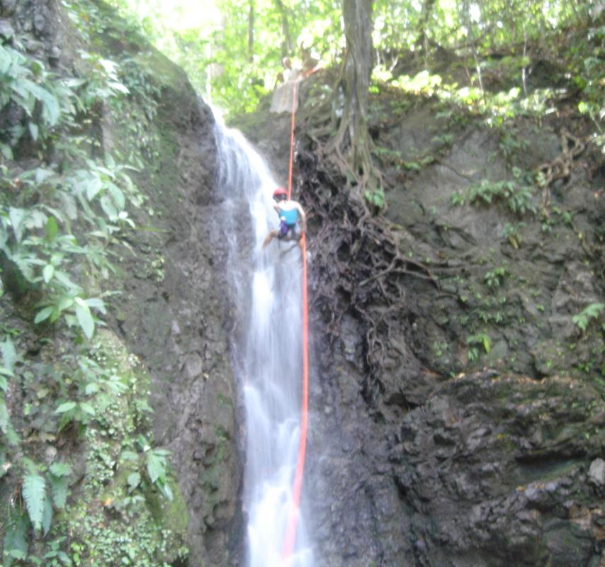Bija repelling a waterfall