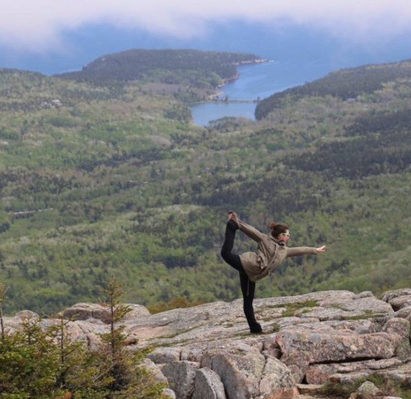 Melissa doing yoga in the Mountains