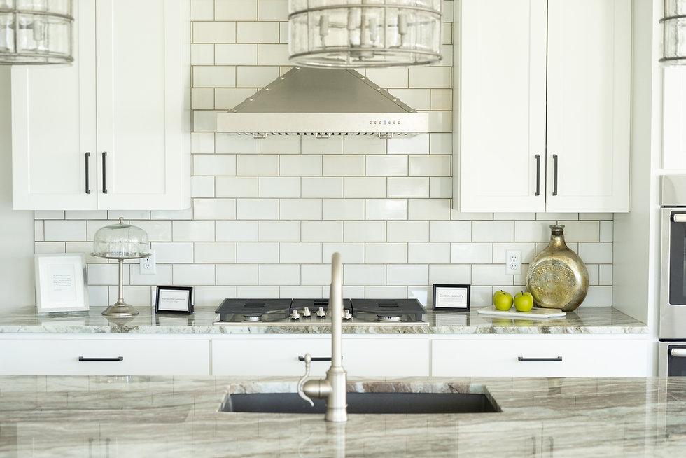 Beautiful white kitchen with subway tile backsplash