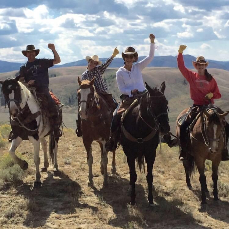 Dana and her family horseback riding