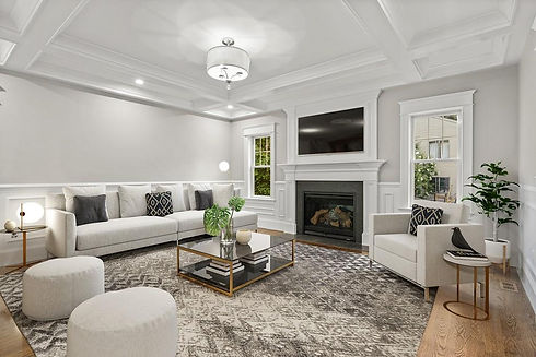 Living Room staged with fireplace and coffered ceilings