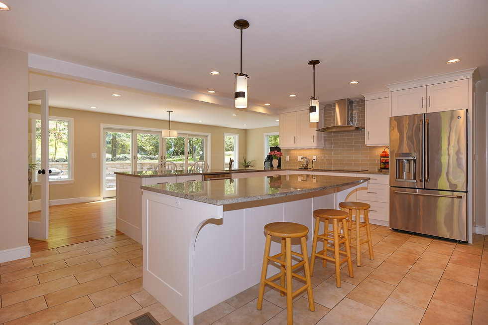 Open Concept Kitchen and Dining with granite countertops
