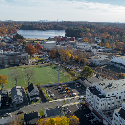 Wakefield Station drone photo above of school with sports fields across the street