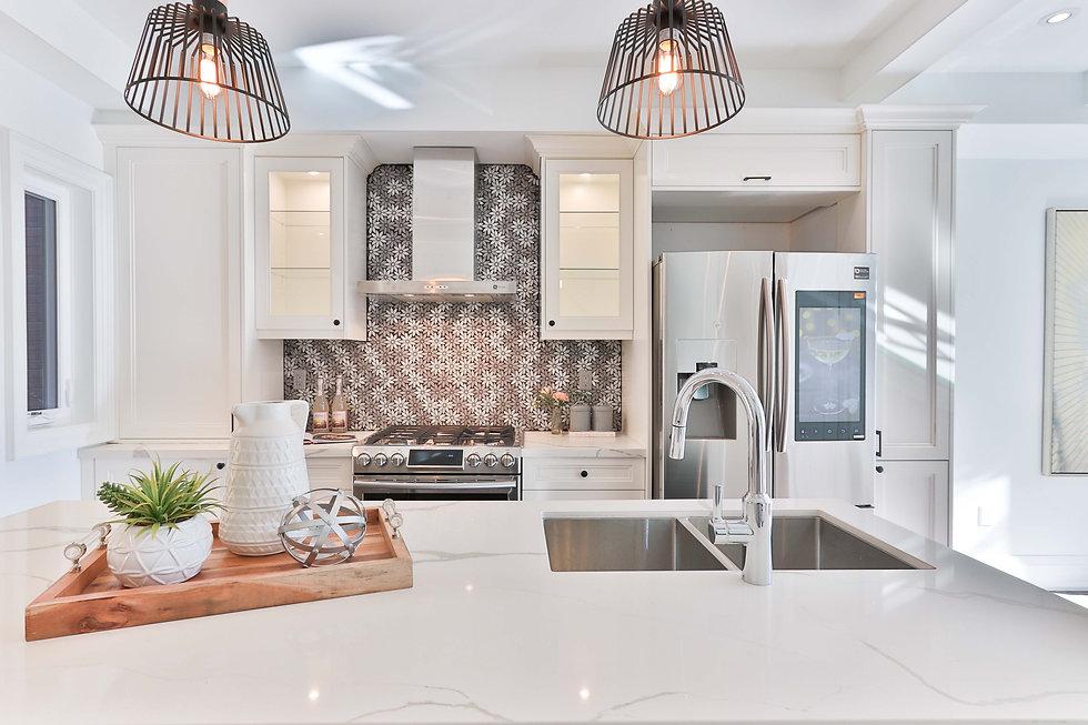 High end kitchen with patterned backsplash