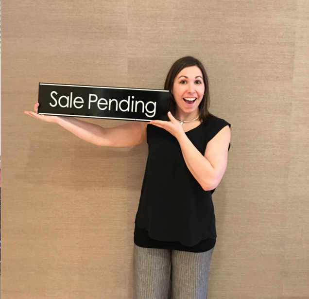 Melissa with a Sale Pending Sign