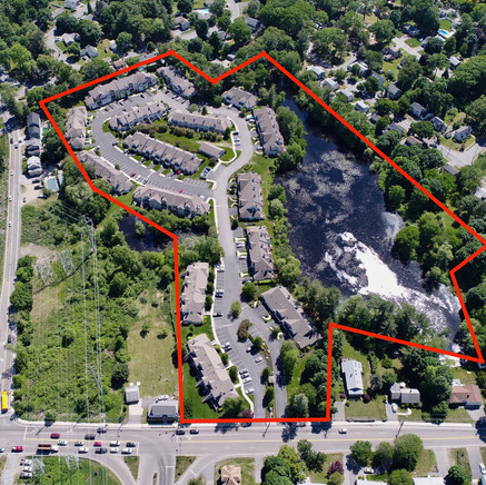 Heron Pond drone photo of neighborhood with outline of new development