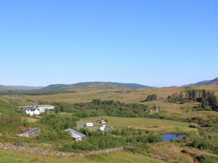 View of farmhouse and campsite