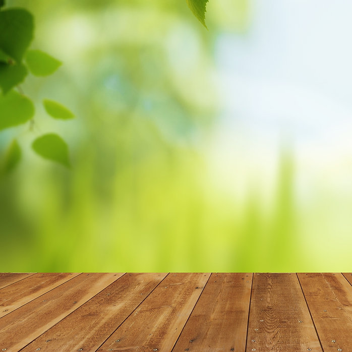 Background image wooden floor with soft light through foliage.