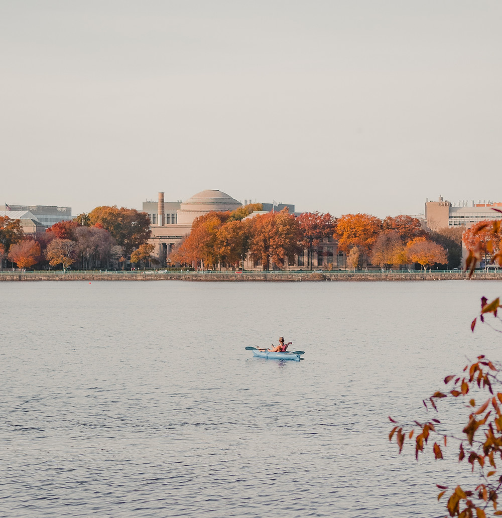 a lone kayaker in the Charles River