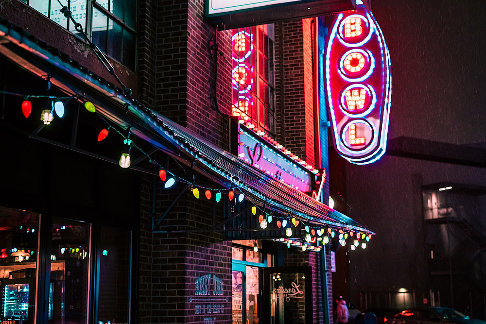neon lights and signage in the city