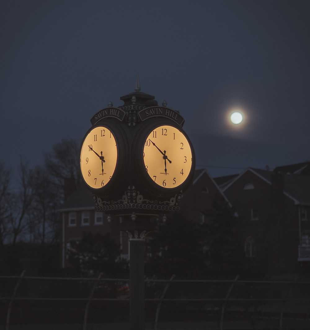 The moon and a clock make a spooky mood