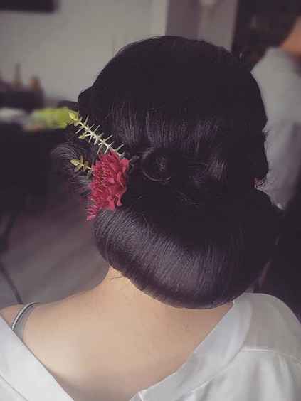 Nice sleek updo for this gorgeous bride