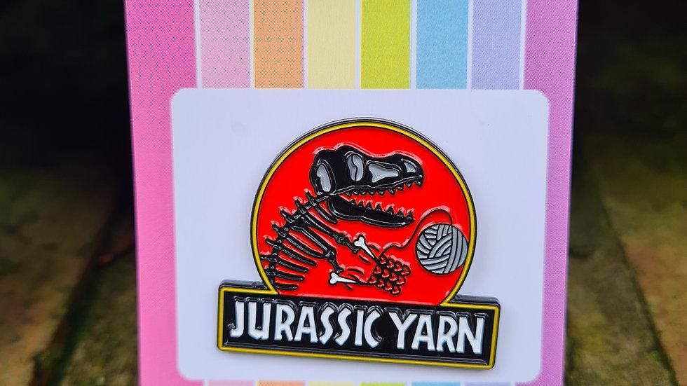 Red Jurassic Yarn enamel pin