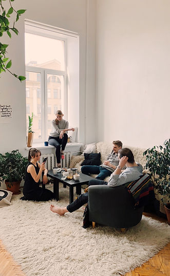 people-gathered-inside-house-sitting-on-