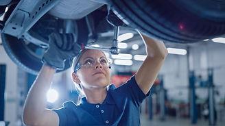 Portrait Shot of a Female Mechanic Worki