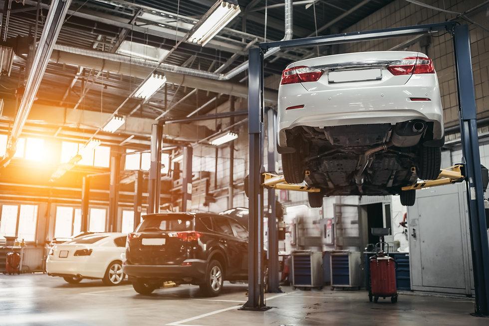 Car raised on car lift in autoservice..jpg