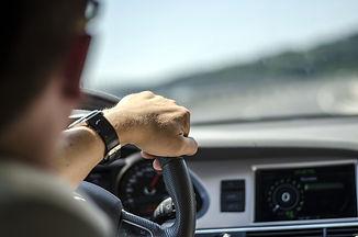 Generic photo of man driving a car throu