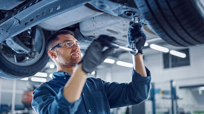 Portrait Shot of a Handsome Mechanic Wor